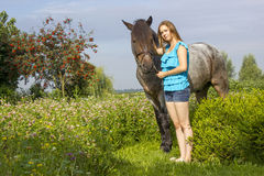 Young girl with horse Royalty Free Stock Photo