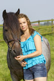 Young girl with horse Stock Photo
