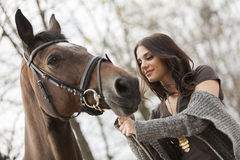 Young girl with a horse Stock Photo