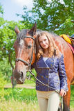 Young girl with a horse Royalty Free Stock Image
