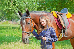 Young girl with a horse Stock Images
