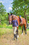 Young girl with a horse . Royalty Free Stock Photos