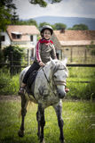 Young girl on horseback Stock Photos