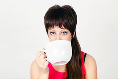 Young girl with a huge mug Royalty Free Stock Photos