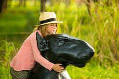 Young girl hugging a dog sculpture royalty free stock images
