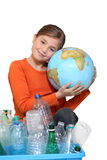Young girl hugging a globe Stock Images