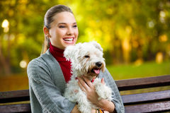 Young  girl hugging  her dog. In park Stock Photos