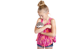 A young girl hugging her pet hedgehog,. Isolated on a white background Stock Photo
