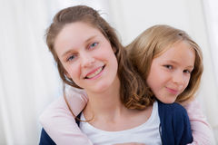 Young girl hugging his sister Royalty Free Stock Photos