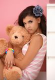 Young girl hugging toy bear Royalty Free Stock Image