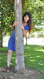 Young girl hugging a tree Stock Photography