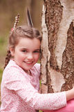 Young Girl Hugging Tree In Forest Stock Images