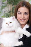 Young girl hugging a white Persian cat stock photos