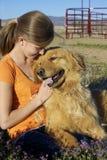 Young Girl Hugs Her Dog Stock Photo