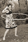 Young girl with hula hoop Stock Photography