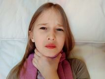 Throat hurts the child royalty free stock photo