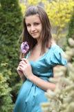 Young girl with hyacinth Stock Image