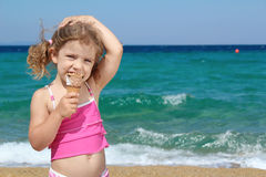 Young girl with ice cream. On the beach Royalty Free Stock Image