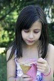 Young girl with ice cream stock photography