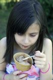 Young girl with ice cream stock image