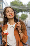 Young girl with ice cream smiling. In town Royalty Free Stock Photo