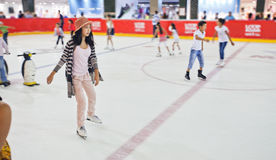 Young girl at the ice rink. Stock Photos
