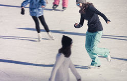 Young girl at the ice rink outdoor Royalty Free Stock Images