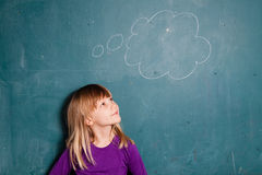 Young girl and idea bubble on chalkboard Stock Photos