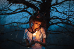 Young girl in the image of a bride with lighted candles in their Stock Photography