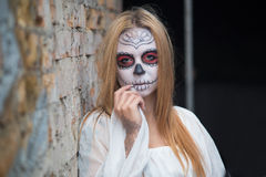 Young girl in the image of Santa Muerte Royalty Free Stock Image
