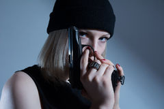 Free Young Girl In A Dark Cap With A Gun In His Hand Royalty Free Stock Photography - 37191417