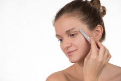 Young Girl In A Red Towel Caring For Your Eyebrows With Trimmer Stock Photography