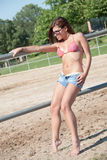 Young Girl In The Farm Farm With Top Bikini And Shorts Stock Image