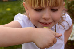 Young girl with inchworm stock photo