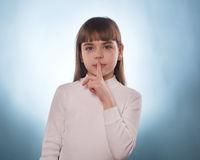 The young girl with the index finger down or up isolated Royalty Free Stock Photos