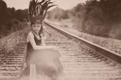 Young girl. Indian girl headdress railroad thinking vintage fog Royalty Free Stock Image