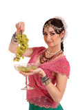 Young girl in the Indian national dress with grapes Stock Photos