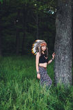 Young girl in an Indian roach in the forest. At sunset Royalty Free Stock Photos