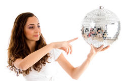 Young girl indicating disco ball Stock Photo