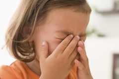 Young girl indoors crying Stock Image