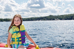 Young girl on inflatable, ready to go Royalty Free Stock Photography