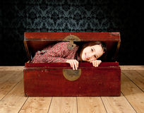 Young girl inside an ancient trunk Royalty Free Stock Photography