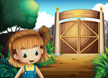 A young girl inside the gated yard Stock Image