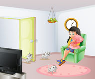 A young girl inside the room with her pets Royalty Free Stock Photo