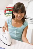 Young Girl Ironing Stock Photos