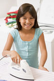 Young Girl Ironing Royalty Free Stock Photography