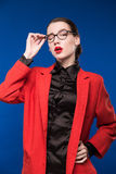 Young girl in a jacket with red lips Royalty Free Stock Photos