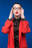 Young girl in a jacket with red lips Royalty Free Stock Images