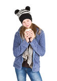Young girl with jacket and wooly hat holding cup Royalty Free Stock Images