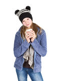 Young girl with jacket and wooly hat holding cup. Isolated on white background Stock Image